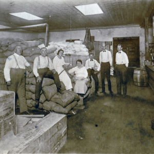 S.B. Poston - left - with associates in storeroom - circa 1920.jpg