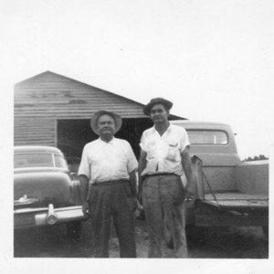 Ottis Guinan Huggins,Sr. and O. G. Huggins, Jr. in front of The Little Store, The Mill.jpg