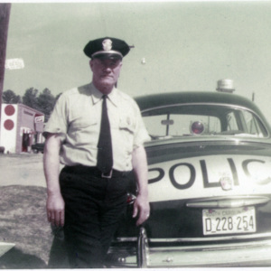 Police Chief Lurie Poston Sr with police car on Broadway