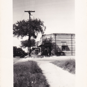 Broadway and Poston Grocery 1941 - New Theater and Esso station signs visible.jpg
