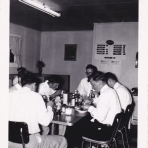 Cottage Lunch 1952, Delance Poston head of table with glasses after lower state championship.jpg